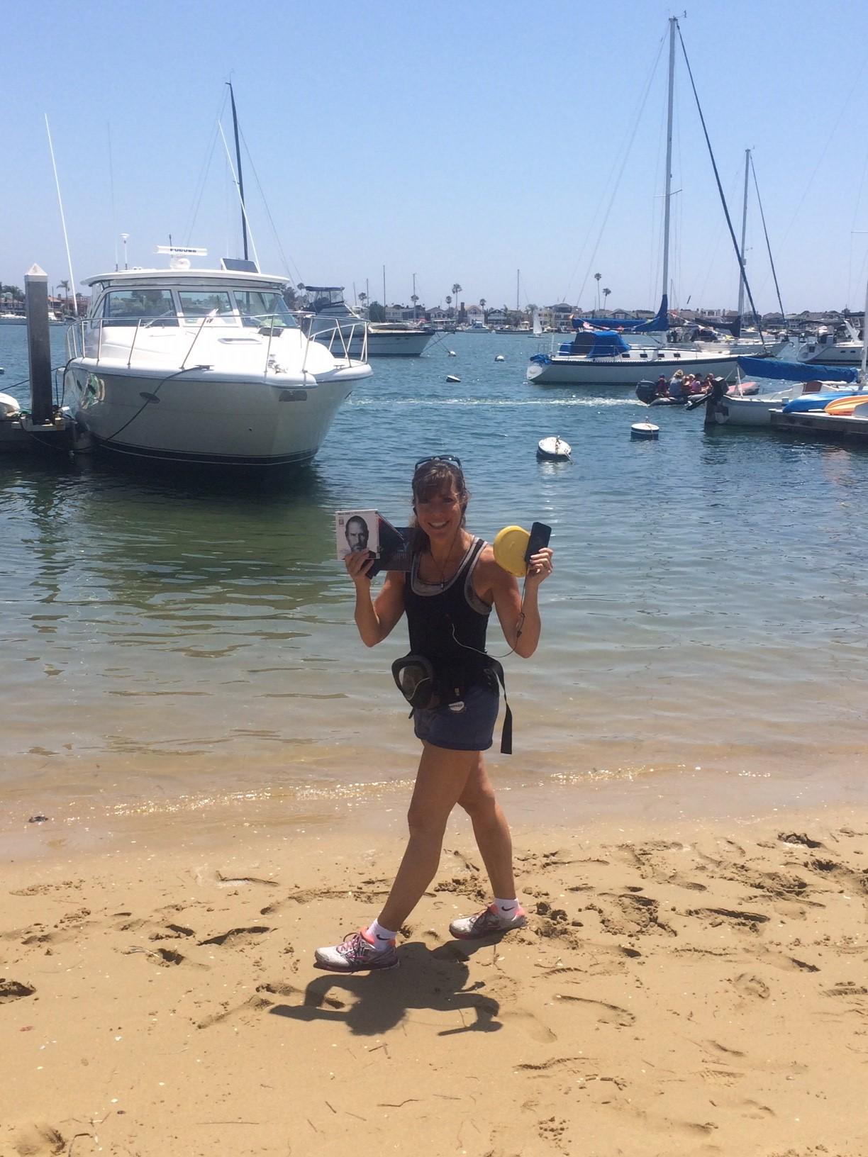 Terri with her audio books on the beach